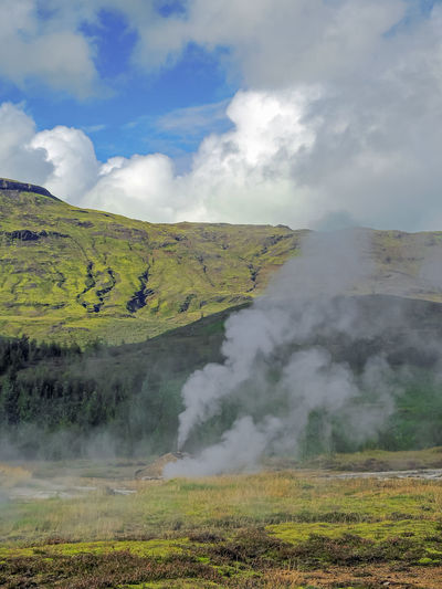 Cloud - Sky Beauty In Nature Environment Sky Scenics - Nature Landscape Day Non-urban Scene Nature Tranquility Tranquil Scene No People Mountain Steam Smoke - Physical Structure Land Plant Heat - Temperature Outdoors Green Color Hot Spring Power In Nature Iceland Geyser Geysir Hot Springs