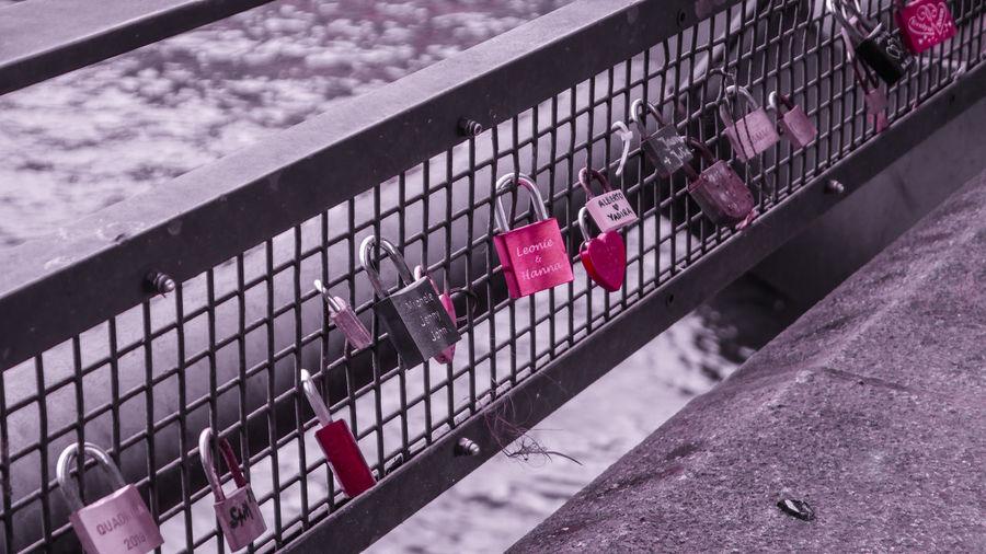 High angle view of padlocks on railing