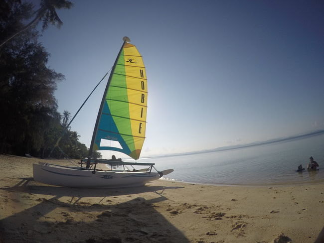 Beach Beauty In Nature Clear Sky Horizon Horizon Over Water Incidental People Land Leisure Activity Mode Of Transportation Nature Nautical Vessel Outdoors Real People Sailboat Sand Sea Sky Sport Transportation Water