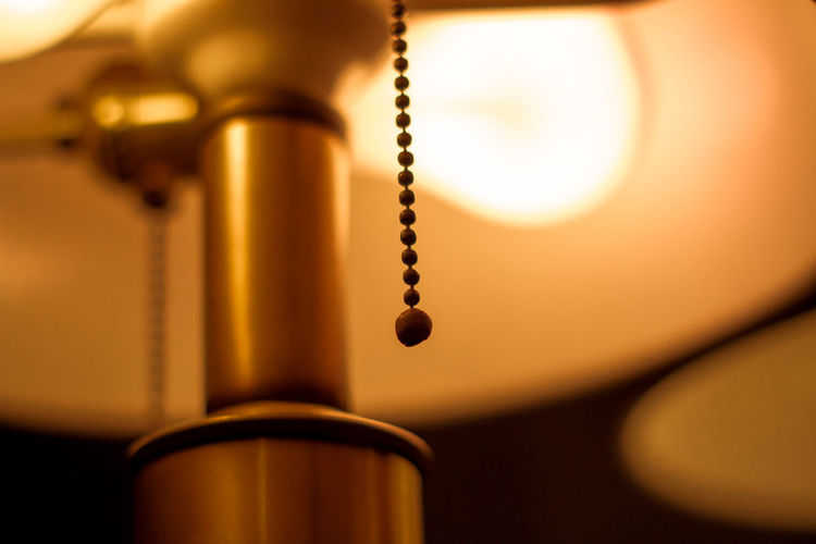 Cropped image of electric lamp