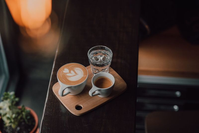 Filling that palate Drink Food And Drink Indoors  Table Refreshment Close-up Coffee - Drink Glass Focus On Foreground Coffee No People High Angle View Still Life Mug Coffee Cup Cup Freshness Lifestyles Plate