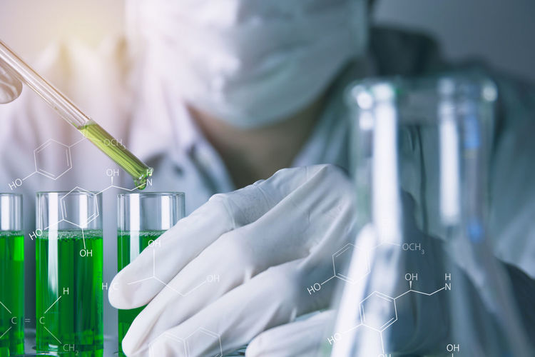 Analyzing Biology Biotechnology Chemical Chemistry Education Healthcare And Medicine Indoors  Lab Coat Laboratory Laboratory Glassware Medical Research Midsection Occupation One Person Protection Protective Glove Research Safety Science Scientific Experiment Scientist Test Tube Working