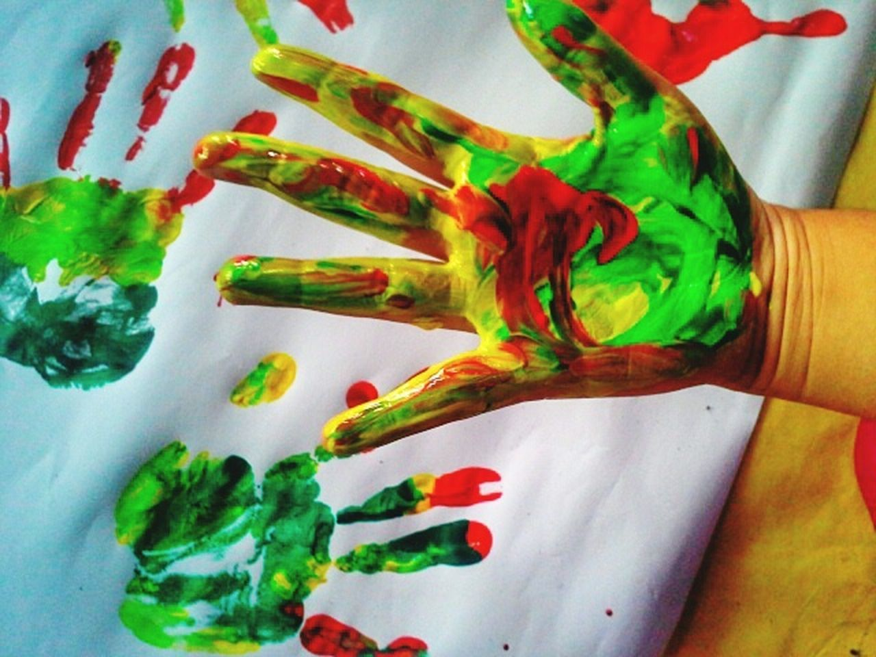 human hand, human body part, one person, human finger, multi colored, real people, indoors, high angle view, close-up, palm, day, holi, one man only, people