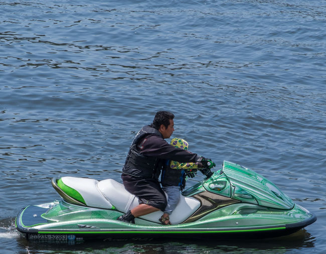 Full length of man sitting in sea