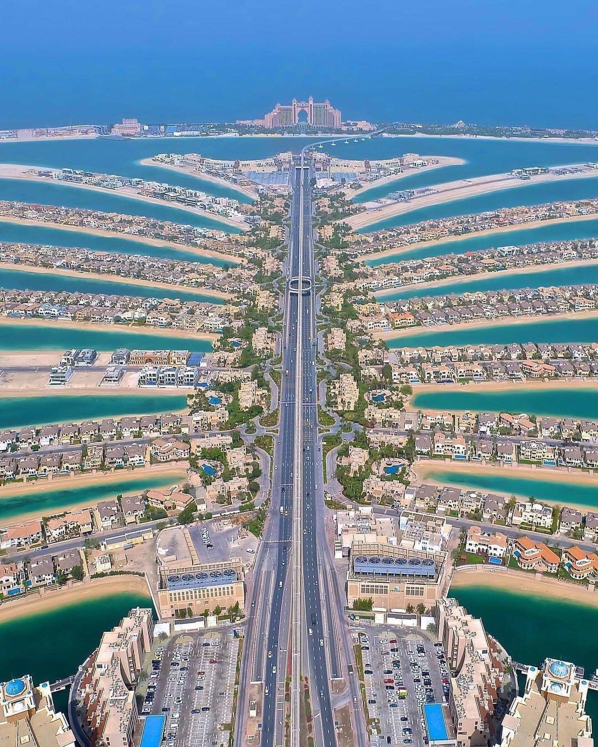 architecture, built structure, city, building exterior, cityscape, high angle view, day, transportation, no people, nature, building, outdoors, aerial view, travel destinations, residential district, connection, road, sky, skyscraper