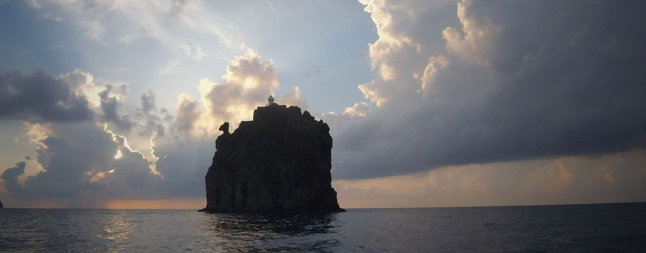 Lo Strombolicchio Darksunset Vulcanic Landscape Sea Clouds And Sky Nature Fredom Island LoveNature Sealight Isoleeolie Water Sunset Sky