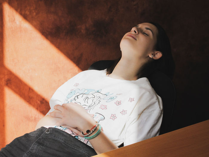 High angle view of sleeping woman