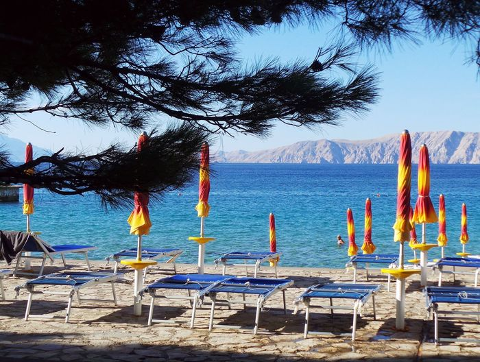 Beach Photography Croatia Adriatic Beach Beauty In Nature Blue Chair Day Group Of Objects Nature No People Novi Vinodolski Outdoors Sand Scenics Sea Sea And Sky Sky Tranquil Scene Tranquility Tree Umbrellas Umbrellas On The Beach Vacations Water An Eye For Travel