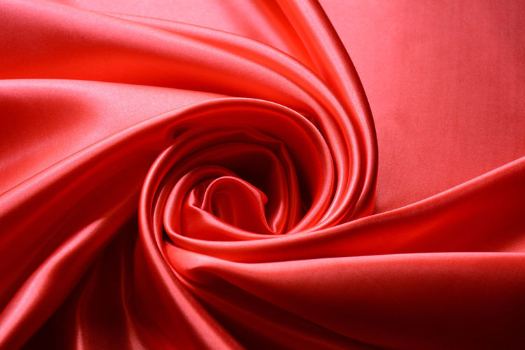 Red Background Fabric Space Folds Closeup Shine Satiny Soft Curtain Silky Drape Cloth Silk Luxury Fashion Smooth Macro Flowing Elegant Shiny Satin Bedding Texture Design Color Ripple Linen Sheet Curves Crumpled Delicate Textile Softness Material Graceful
