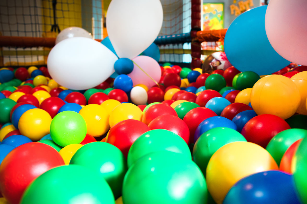 CLOSE-UP OF MULTI COLORED BALLOONS BALL