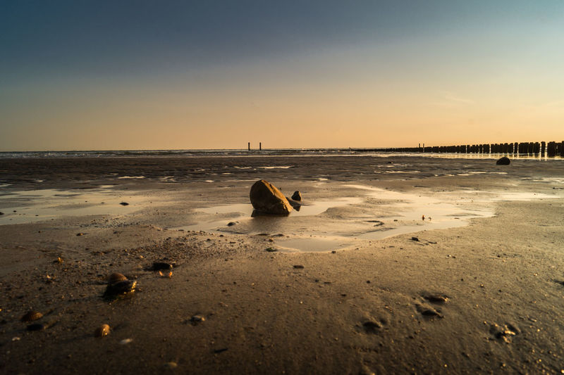 Westkapelle -Netherlands Beach Beauty In Nature Clear Sky Day Horizon Over Water Nature No People Outdoors Sand Sea Sky Stone Sunset Tranquil Scene Water