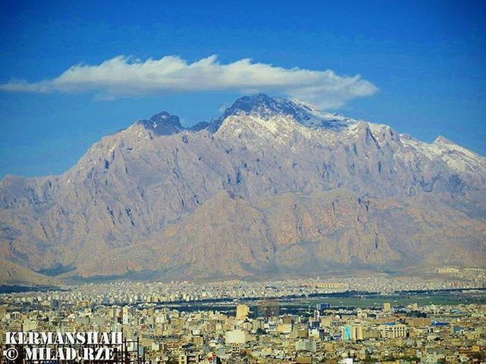 Paraw mountain is the highest peak in Kermanshah...The height of the mountain is 3357 meters above sea level. ___________________________________ 🗻 کوه پراو (به کردی: پهڕاو، به معنای پر آب) بلندترین قلۀ شهر کرمانشاه با ۳۳۵۷ متر از سطح دریا در شمال شرقی شهر کرمانشاه واقع شده است.غار پراو یکی از غارهای عمودی برتر جهان است. یکی از ویژگیهای منحصر به فرد غار پراو وجود دهانه آن در ارتفاع سه هزار متری از سطح دریا است که این بالاترین سطح در بین تمام غارهای دنیا میباشد. در سال ۱۳۸۸ غار پراو توسط سازمان حفاظت محیط زیست ایران به عنوان اثر طبیعی ملی به ثبت رسید. ___________________________________ کوه شهر طبیعت ابر آسمان  قله کوهستان پراو زیبا دلنواز عشق زندگی برف عکاسی Mountain City Nature Cloud Sky Peak Mountain Rough Beautiful Smooth Love Life Snow Photography paraw