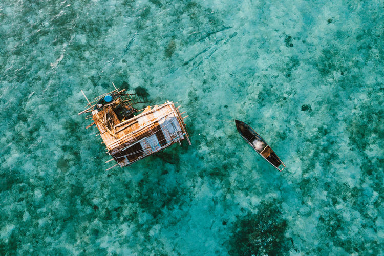 High angle view of boat floating on sea