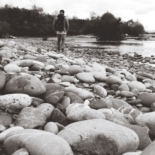 Full length of woman standing on pebbles