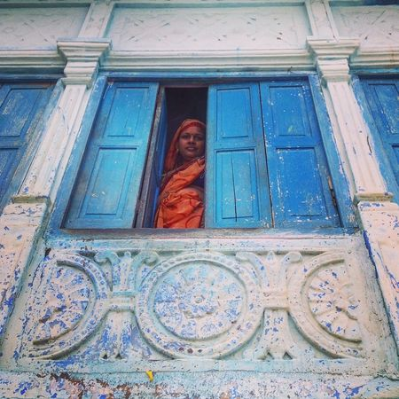 The Street Photographer - 2016 EyeEm Awards The Blue City Jodhpur Rajasthan Traditional Culture Architectural Feature Woman Looking Down Woman In Window Looking Up Indian Culture  Façade Lifestyles EyeEm EyeEm Best Shots Eye4photography  EyeEm Best Edits EyeEmBestPics People Of EyeEm Blue Front Old Building