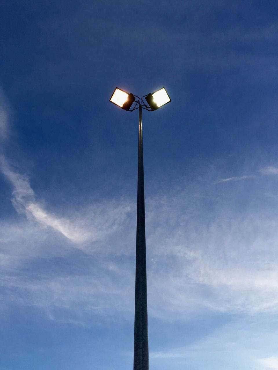 Low Angle View Halogen Light Against Sky