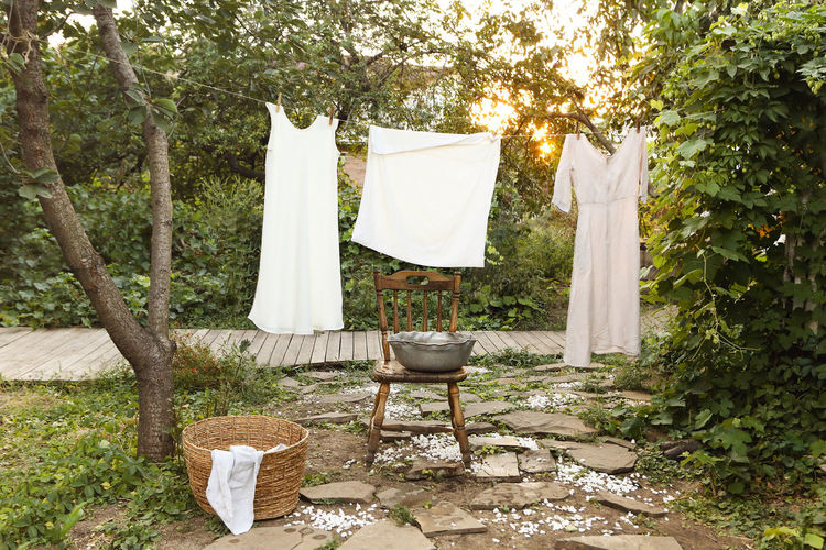 Clothes drying on chair in yard