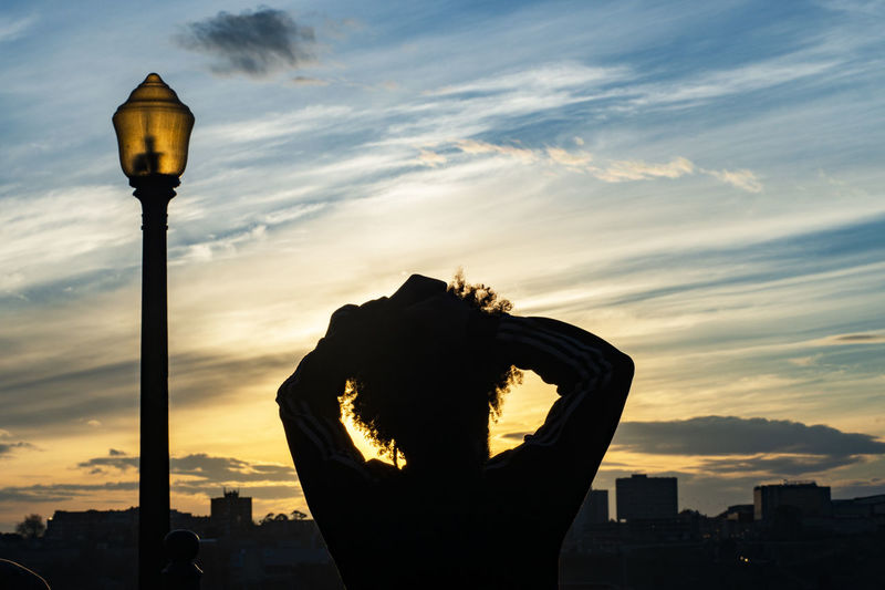 Sunset relaxation City Life Citybreaks Cityscape Porto Portugal Relaxing Sunsetinporto Vacations View Arms Raised Cloud - Sky Curlyhair Silhouette Sky Street Light Sunset Tourism Tourism Destination Tranquility Scene