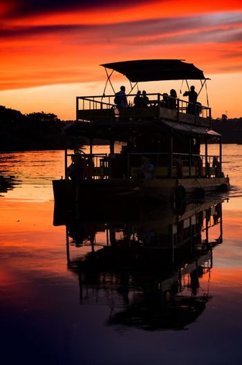 Sunset Reflection Tropics Uganda  Africa Chill Mellow Evening Travel Destinations Vacations Riverside Adventures Nile River Scenics Tourism Tourists Cruise Silhouette Boat Trip Water