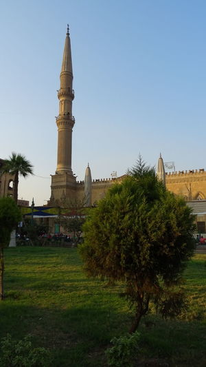The mosque at the Khan Al-Khalili market in Cairo, Egypt Mosque Islam Islamic Architecture Park Egypt Cairo Travel City Place Of Worship Religion History Tree Cityscape Spirituality Cultures Architecture Tower Tall - High International Landmark Tourist Attraction  Tall Architectural Feature