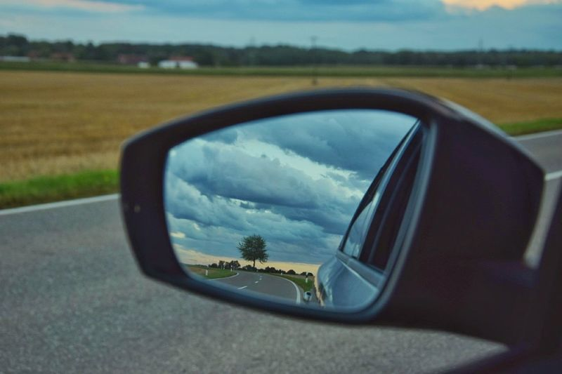 Car Side-view Mirror Mirror Reflection Vehicle Mirror Transportation Sunglasses Road Road Trip Mode Of Transport Travel Day Landscape No People Sky Nature Outdoors Close-up