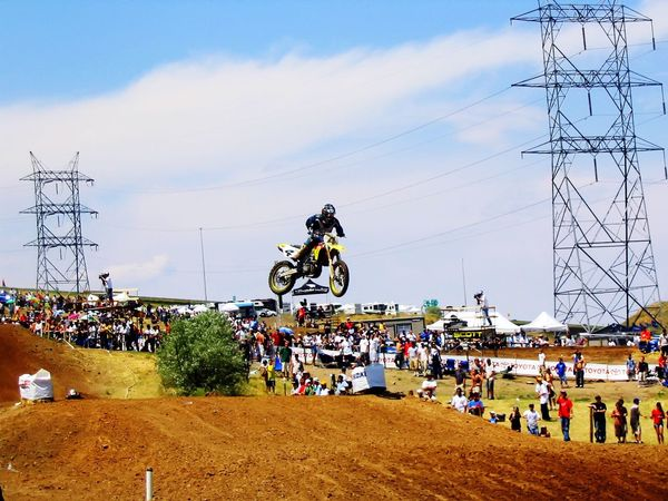 Large Group Of People Real People Sky Men Cloud - Sky Spectator Outdoors Day Crowd Adventure Lifestyles Motorcycle Sitting Women Electricity Pylon Sports Race Tree Biker People motocross Action
