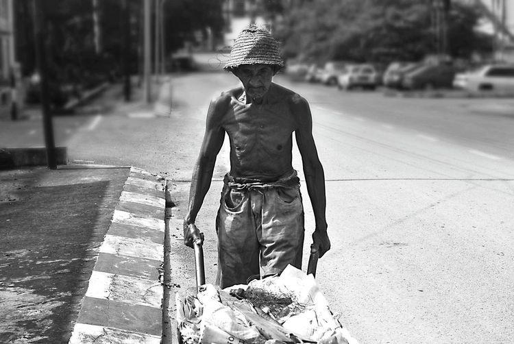 EyeEmNewHere One Person Outdoors Full Length People Day Road Adult Headwear One Man Only MEN'S JOB Men's Story Men's Lives Matter, Too Adults Only Only Men Young Adult Men At Work  The Week On EyeEm