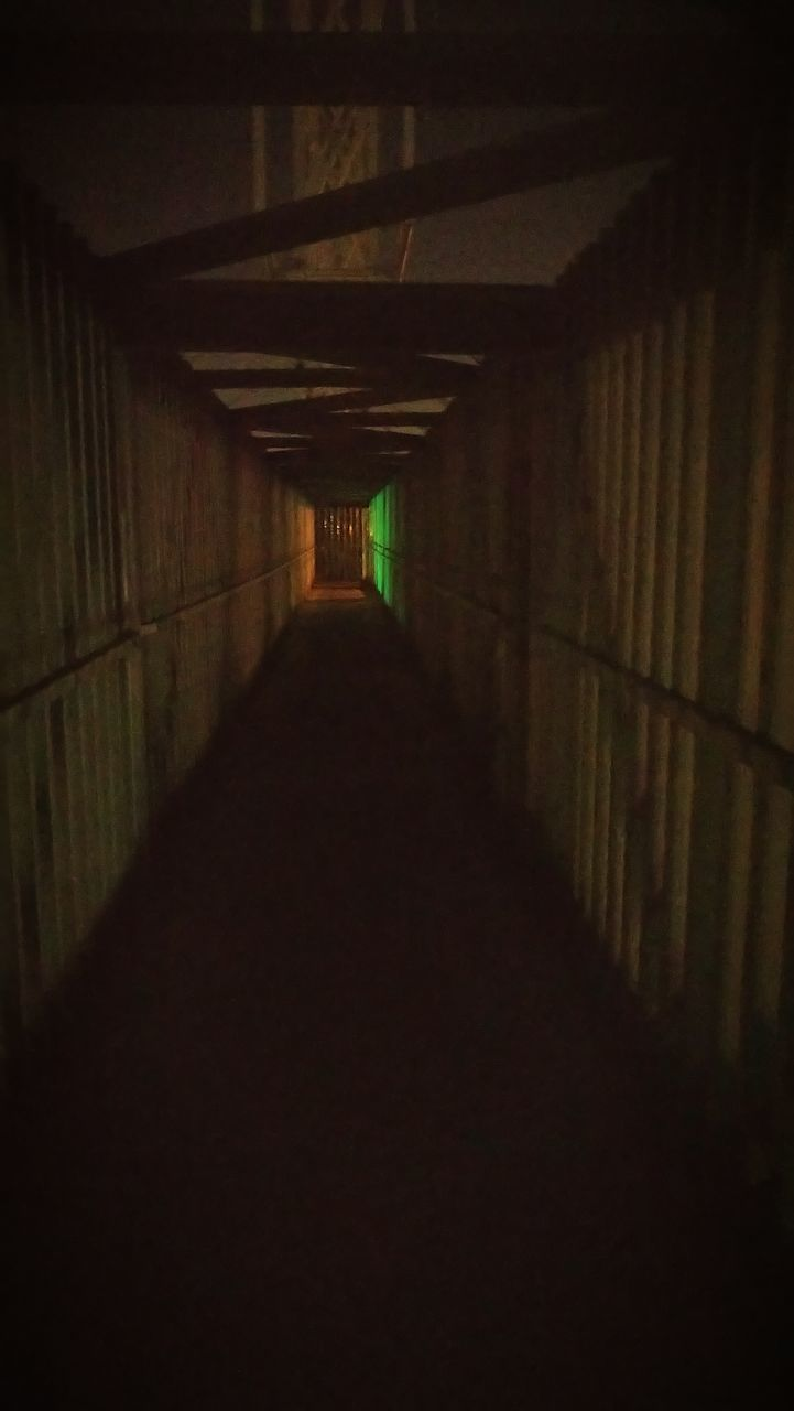 architecture, the way forward, direction, arcade, built structure, diminishing perspective, corridor, indoors, illuminated, no people, lighting equipment, empty, in a row, tunnel, building, ceiling, absence, dark, night, light, light at the end of the tunnel, long, underpass