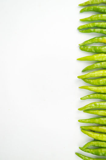 High angle view of vegetables against white background