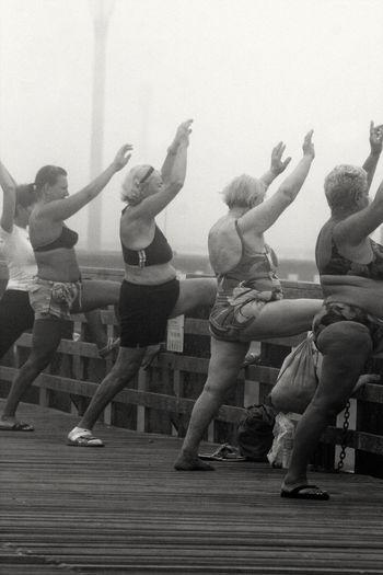 Synchronized in the fog. Blackandwhitephotography Bikini Bikini Time❤ Women Exercise Pier Coney Island Coneyisland Fog Brooklyn