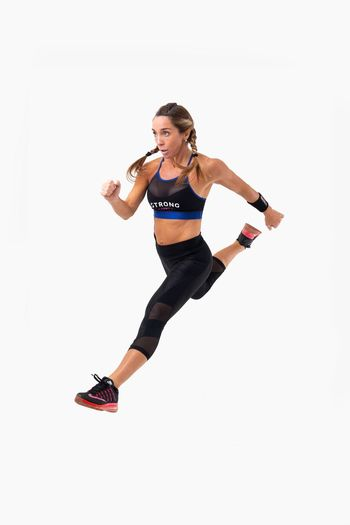 Lifestyles Studio Shot White Background Strong Fitness Fitness Training Fitness Model Zumba Zumba Fitness Strong Woman Sportive Active Wear Attitude Jumping HIIT Kicks Training