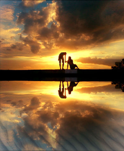 Couple Romantic Beauty In Nature Cloud - Sky Couple - Relationship Leisure Activity Lifestyles Men Nature Ocean Orange Color Outdoors People Real People Reflection Scenics Silhouette Sky Sun Sunset Togetherness Tropical Water Women