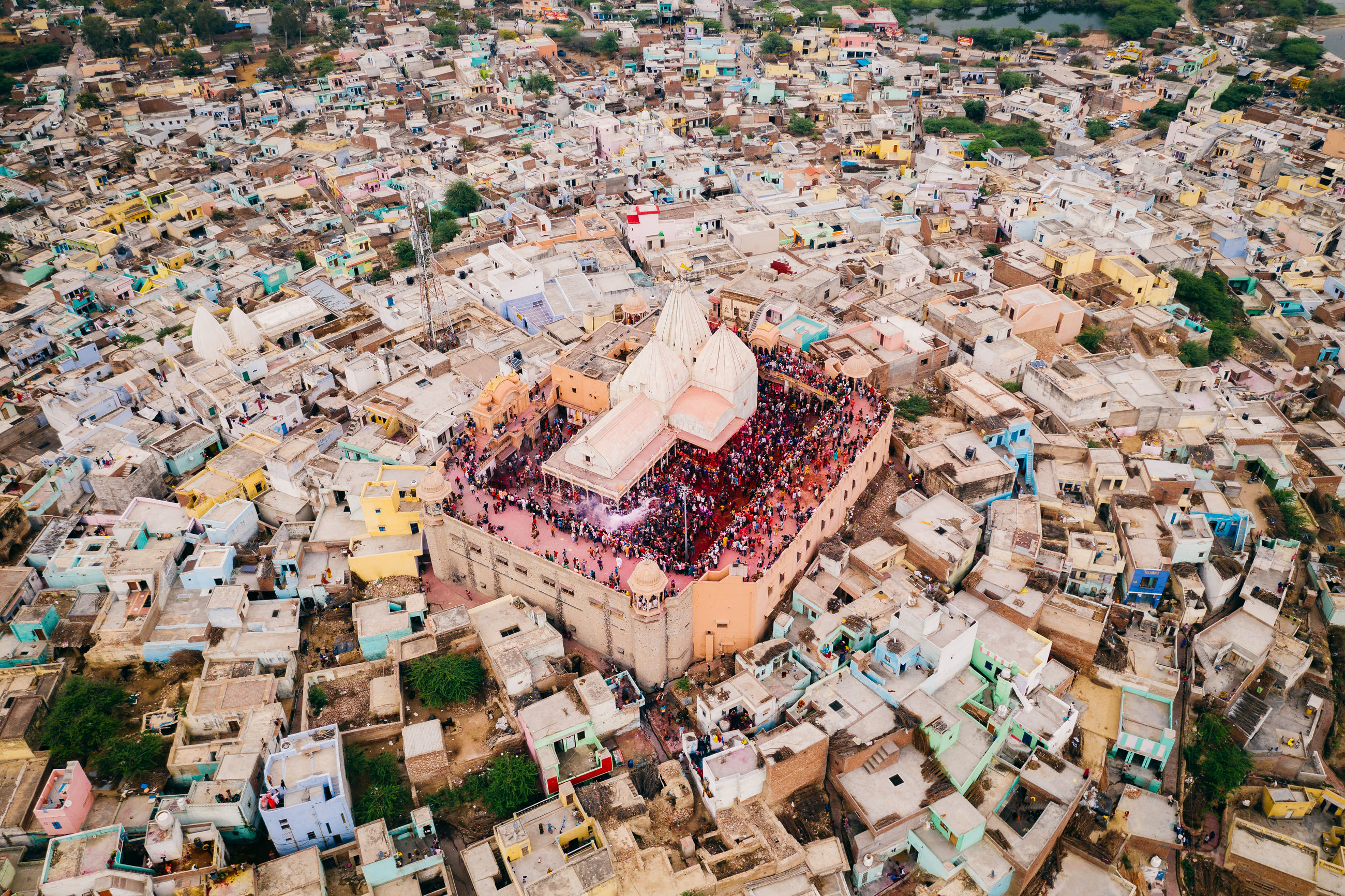high angle view, architecture, building exterior, day, crowd, city, crowded, built structure, outdoors, aerial view, nature, garbage, cityscape, large group of objects, abundance, building, group of people, celebration, town