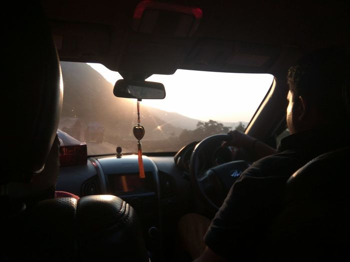 Rear view of people traveling in car