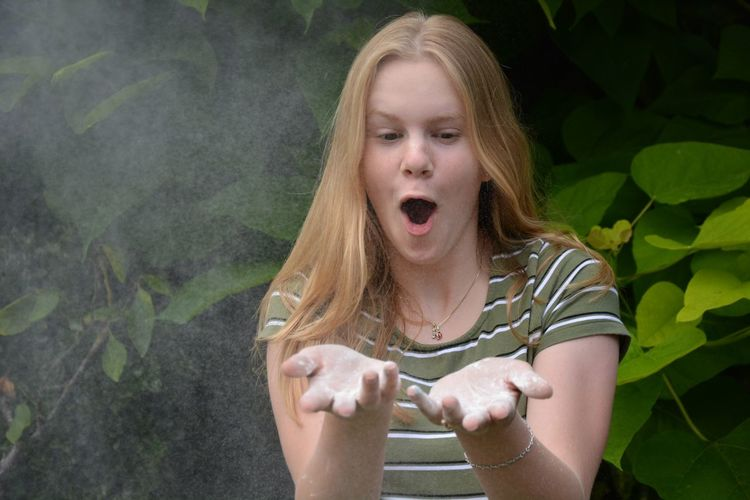 Blowing powder Having Fun Fun Outdoors Fun Chalk Blowing Explosion Powder EyeEm Selects Mouth Mouth Open One Person Front View Real People Women Portrait Young Women Emotion Young Adult Hair Leisure Activity Lifestyles Child Girls Day Blond Hair Childhood Hairstyle