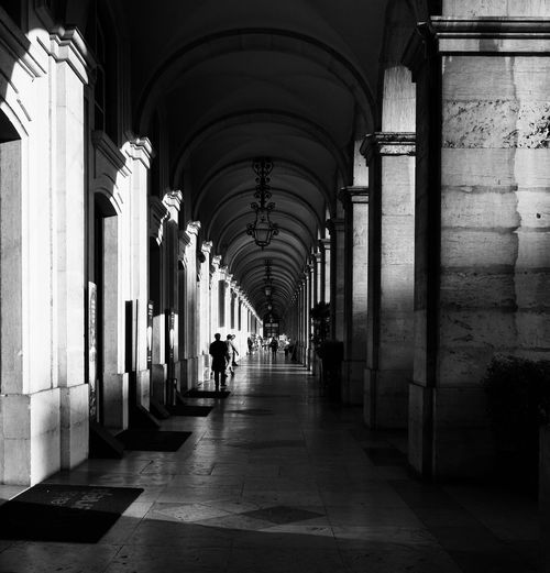Architecture The Way Forward Direction Built Structure Arch Arcade Architectural Column Corridor Walking Building Indoors  In A Row Day Real People Diminishing Perspective Lifestyles Men Incidental People Colonnade Flooring Ceiling