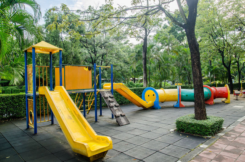 Childhood Day Growth Jungle Gym Monkey Bars Nature No People Outdoor Play Equipment Outdoors Park - Man Made Space Playground Slide - Play Equipment Swing Tree Water Slide Yellow