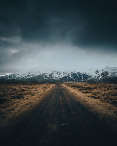 Road to nowhere The Way Forward Direction Sky Road vanishing point Mountain Transportation Diminishing Perspective Environment Landscape Cloud - Sky Snow Cold Temperature Scenics - Nature Beauty In Nature Tranquil Scene No People Winter Nature Snowcapped Mountain Outdoors Long Iceland