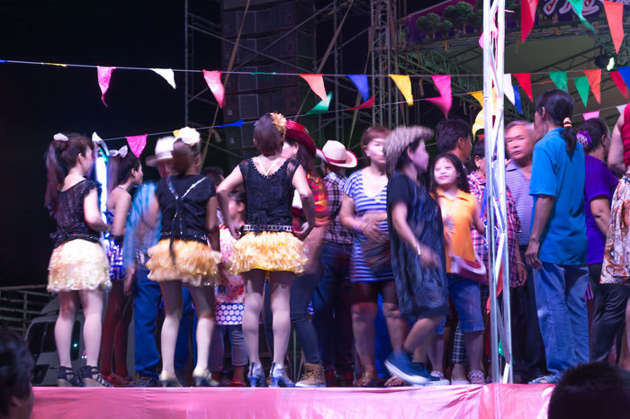 Arts Culture And Entertainment Crowd Enjoyment Fun Illuminated Large Group Of People Leisure Activity Lifestyles Men Multi Colored Night Outdoors People Performance Real People Standing Togetherness Women Nakhon Pathom Thailand Thai Dance Dancers Dance Show Singer  Dancing