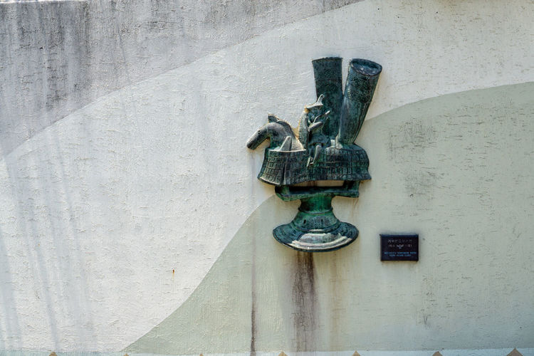Close-up of antique sculpture on wall