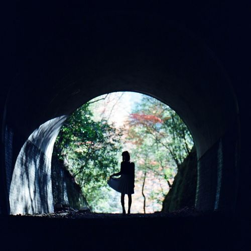 Silhouette Woman Standing Outside Tunnel