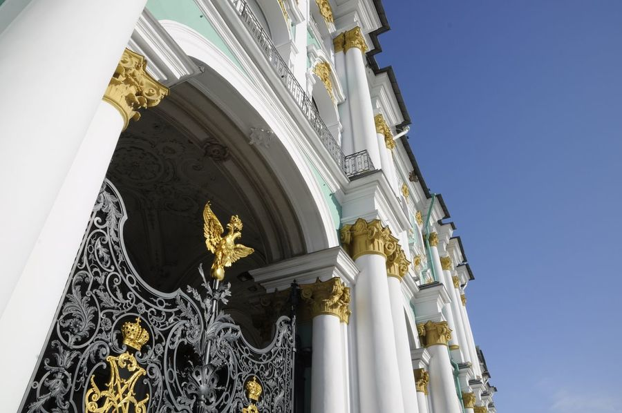 Gates of the Winter Palace Architecture Blue Sky Building Exterior Built Structure City Cloudless Day Eagle Façade Gate Gold Gold Gold Colored Golden Historic Place Low Angle View No People Outdoors Palace Gates Religion Saint Petersburg Sky Symbol Travel Destinations Winter Palace