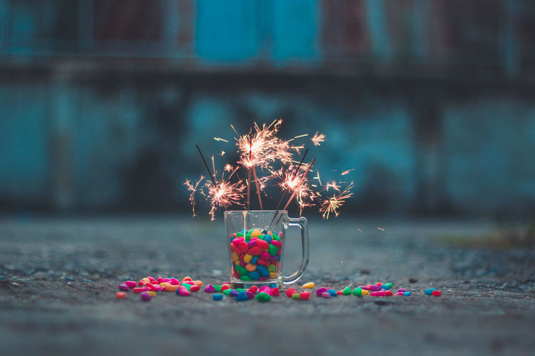 Sparkler and gravel Green Color Pink Color Blue Red Gravel Warm Orange Hot Glow Star Fun Energy Backgrounds Light Winter Sparkler Party Firework EyeEmNewHere EyeEm Selects EyeEm Fireworksphotography Focus On Foreground