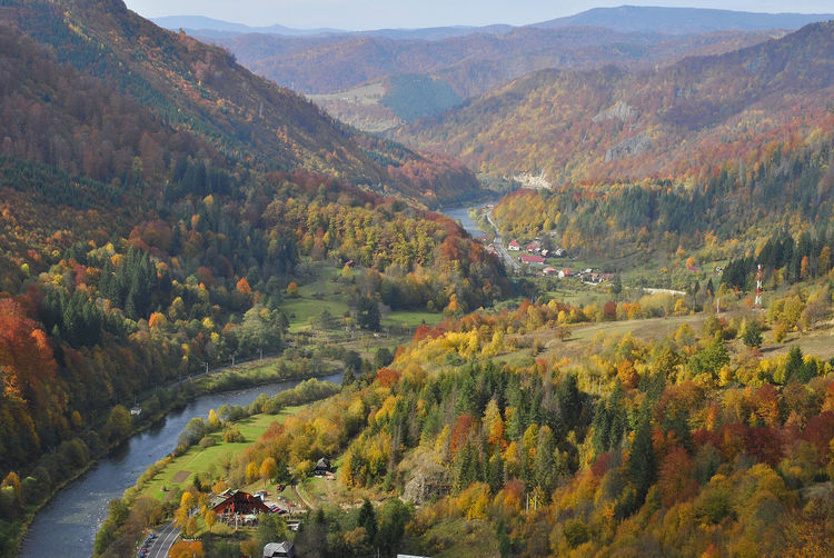 High angle view of river by mountains during autumn