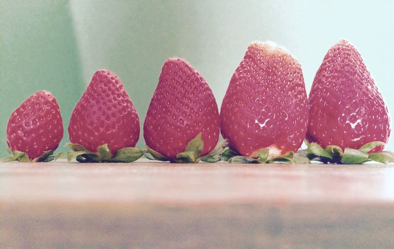 Close-up of strawberries arranged on table