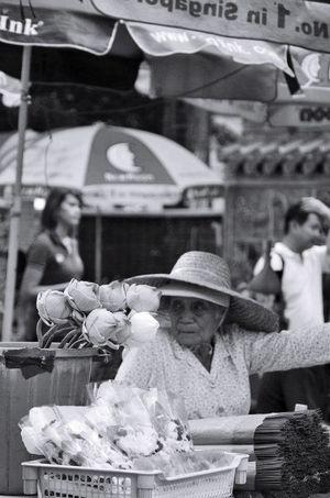 Divine intervention Lotus Lotus Flower Pray Praying Temple Street Photography Street Life Street Peddler Black And White Blackandwhite Black And White Photography Black And White Collection  Black And White Portrait Divine