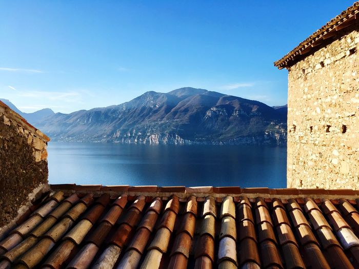 Scorcio sul Lago di Garda Blue Architecture Sky No People Tiled Roof  Day Water Mountain Built Structure Mountain Range Building Exterior Nature Outdoors First Eyeem Photo EyeEmNewHere