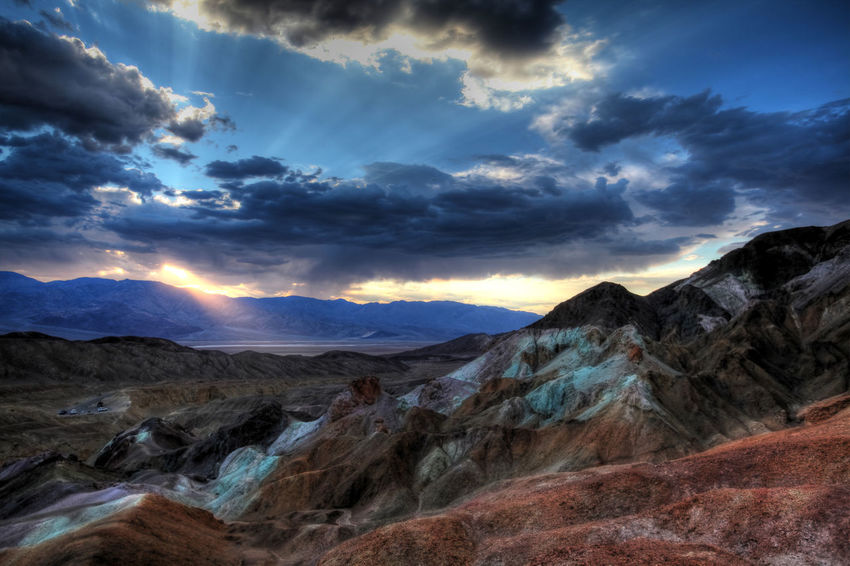 colorful painted hills at Death Valley, USA, during dramatic sunset Death Valley National Park Dramatic Sky Beauty In Nature Cloud - Sky Colorful Dramatic Landscape Environment Idyllic Land Landscape Mountain Mountain Range Nature No People Non-urban Scene Outdoors Remote Rock Scenics - Nature Sky Sunrise And Clouds Sunset Tranquil Scene Tranquility Travel