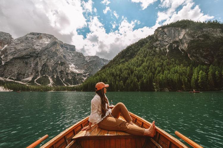 Woman sitting on boat at lake