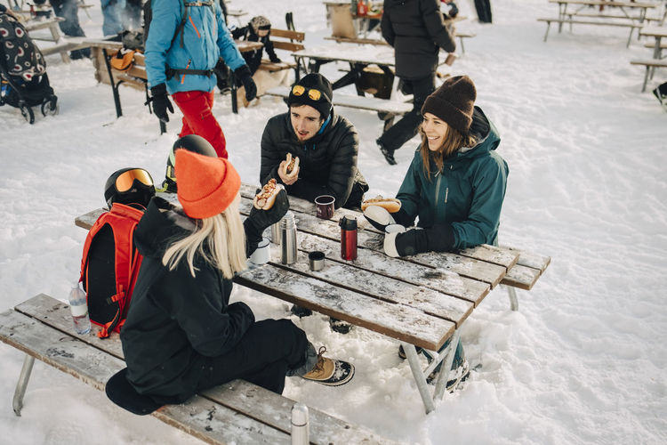 People sitting in snow